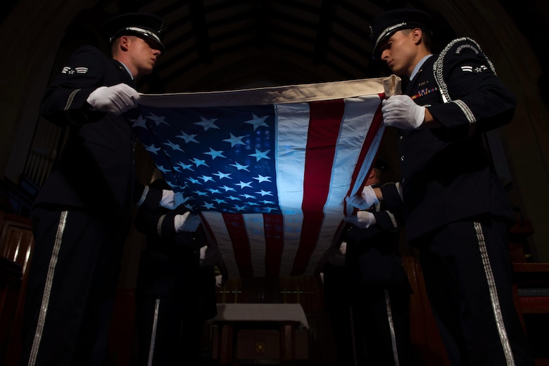 U.S. Air Force service members, assigned to the base Honor Guard, perform a flag folding ceremony at Joint Base Langley-Eustis, Va., June 12, 2017. The flag folding ceremony is a time honored tradition that is used during Memorial Day and Veterans Day ceremonies, as well as retirements from the Armed Forces. (U.S. Air Force photo/ Staff Sgt. Carlin Leslie)