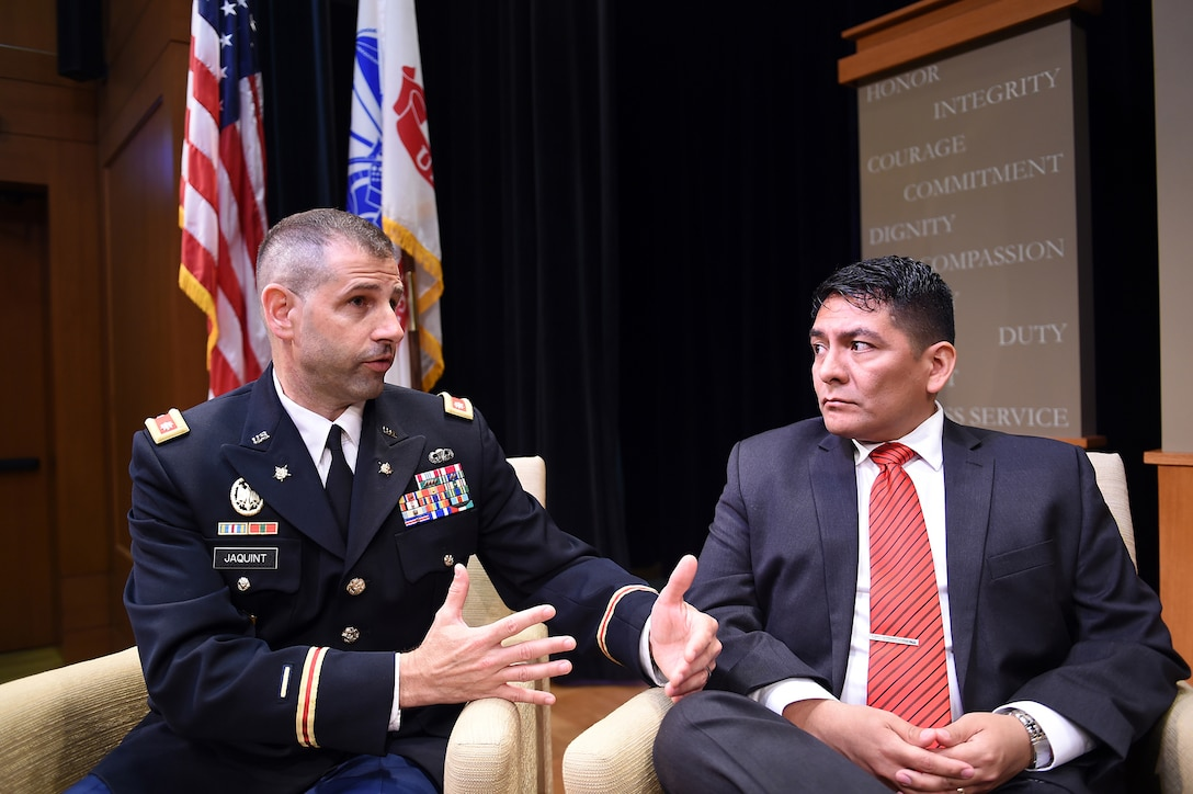 """U.S. Army Reserve Lt. Col. Daniel Jaquint, left, Chief of Staff, 85th Support Command, and Mr. Anthony Taylor, Public Affairs Specialist, 85th Support Command, participate in a live taping interview at the Pritzker Military Museum & Library in Chicago, June 5, 2017. Jaquint and Tay-lor spoke on the history of the 85th Support Command dating back to World War I. The 85th Support Command's lineage began when they were formed as the 85th Infantry Division at Camp Custer, Michigan, where the division was nicknamed the """"Custer Division,"""" on Aug. 5, 1917. The Division was deactivated in 1945 following World War II, then later reactivated in Chicago on February 19, 1947 into the U.S. Army Reserve as a training division. The 85th Spt. Cmd. is celebrating its centennial anniversary this year. (U.S. Army Photo by Sgt. Aaron Berogan/Released)"""