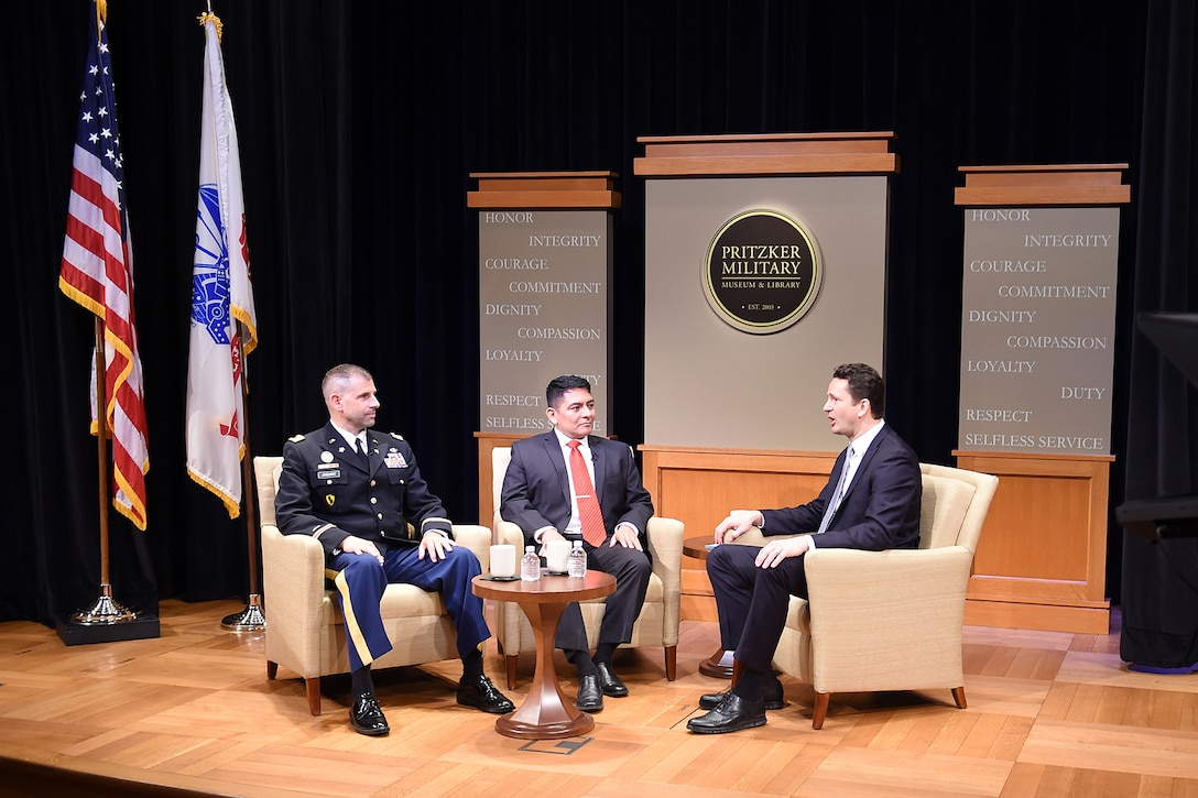 U.S. Army Reserve Lt. Col. Daniel Jaquint, left, Chief of Staff, 85th Support Command and Mr. Anthony Taylor, center, Public Affairs Specialist, 85th Support Command, take part in a live tap-ing interview discussing the 100-year anniversary of the 85th Support Command at the Pritzker Military Museum & Library in Chicago, June 5, 2017. The interview focused on the 85th Sup-port Command's 100-year history dating back to World War I, when it was activated as an active Army component; it also included a discussion on the 85th Spt. Cmd.'s current role as a reserve component. During the interview Jaquint and Taylor both spoke about the importance of the Army Reserve in today's climate. Jaquint emphasized that with some of the actions seen making headlines, the 85th Support Command has a vital role, partnered with First Army, to ensure the readiness and training of Soldiers ahead of mobilizations and deployments to meet the opera-tional needs of the Army and the Joint Warfighter. (U.S. Army Photo by Sgt. Aaron Berogan/Released)