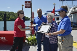 "Diane Parks, chief of operations, U.S. Army Corps of  Engineers, Nashville District, presents a certificate, and thanked (l to r) Frank, Pat and Patty Brendel for their work in taking the initiative to achieve ""Clean Marina"" status and presented the ""Clean marina"" flag."