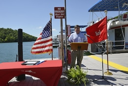 Dale Hollow Lake Resource Manager Stephen Beason, welcomed attendees, recognized partners and commended the Hendricks Creek Marina staff during a dedication ceremony recognizing the marina's voluntary efforts to reduce water pollution and erosion in the Cumberland River watershed, and for promoting environmentally responsible marina and boating practices.