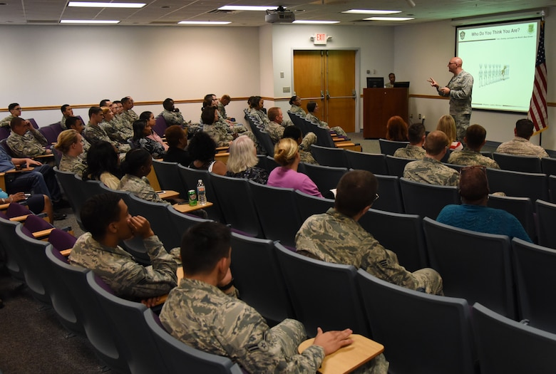 Capt. Adam Dell, 81st Medical Operations Squadron mental health flight commander, provides a suicide prevention briefing to members of the 81st Training Wing staff agency at the Sablich Center June 12, 2017, on Keesler Air Force Base, Miss. The briefing was one of several Wingman Week events focusing on resiliency and teambuilding initiatives across the base. (U.S. Air Force photo by Kemberly Groue)