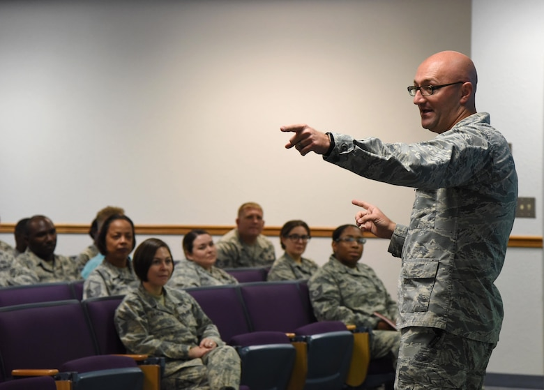 Capt. Adam Dell, 81st Medical Operations Squadron mental health flight commander, provides a suicide prevention briefing to members of the 81st Training Wing staff agency at the Sablich Center June 12, 2017, on Keesler Air Force Base, Miss The briefing was one of several Wingman Week events focusing on resiliency and teambuilding initiatives across the base. (U.S. Air Force photo by Kemberly Groue)