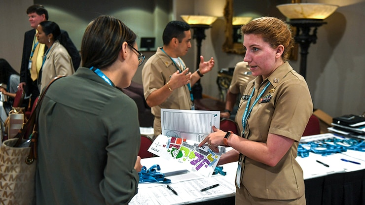 Navy Lt. Cessarina Heg helps a victim's advocate sign in for the 2017 Department of the Navy Sexual Assault Prevention and Response Training Seminar in Orlando, Fla., June 12, 2017. The four-day event provided training to program coordinators, civilian victim advocates, program officers and resiliency counselors. Navy photo by Petty Officer 3rd Class Michael Lopez