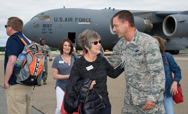 Col. Ethan Griffin, 436th Airlift Wing commander, greets Carlene Joseph with Harborstone Credit Union in Washington, after arriving on a C-17 Globemaster III June 7, 2017 on Dover Air Force Base, Del. Joseph, an Air Mobility Command civic leader to Gen. Carlton Everhart, AMC commander, Scott AFB, Ill., and 18 honorary commanders and civic leaders from Joint Base Lewis-McChord, Wash., came to Dover for a three-day Community Relations Tour. (U.S. Air Force photo by Roland Balik)