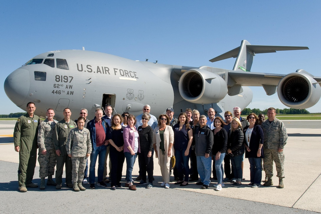 Senior leadership from the 43th Airlift Wing and 62nd AW, along with Joint Base Lewis-McChord, Wash., honorary commanders and civic leaders, pose for a photo in front of a C-17A Globemaster III, June 9, 2017, on Dover Air Force Base, Del. The JBLM group came to Dover for a three-day Community Relations Tour. (U.S. Air Force photo by Roland Balik)