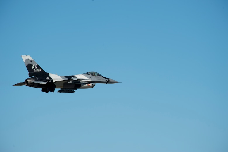 A U.S. Air Force F-16 Aggressor takes off from the flight line during RED FLAG-Alaska 17-2 June 13, 2017, at Eielson Air Base, Alaska. RED FLAG-Alaska provides an optimal training environment in the Indo-Asia Pacific Region and focuses on improving ground, space, and cyberspace combat readiness and interoperabillity for U.S. and international forces.  (U.S. Air Force photo by Airman 1st Class Haley D. Phillips)