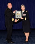 DTRA Deputy Director Rear Adm. Scott Jerabek presents JIDO Vice Director Army Maj. Gen. Julie Bentz an expression of appreciation for her presentation commemorating the Army birthday.