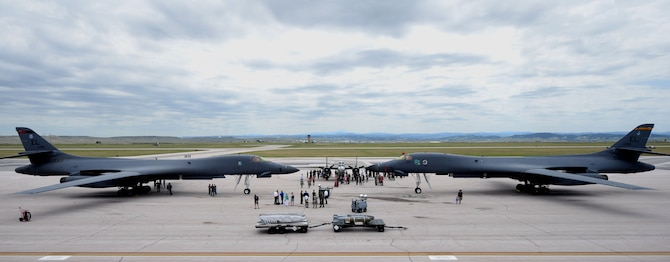 Airmen and their families attend a static display at Ellsworth Air Force Base, S.D., June 12, 2017. Two B-1 bombers, a B-52 Stratofortress and a B-25 Mitchell bomber were on display for the 100th birthday of the 34th and 37th Bomb Squadrons. (U.S. Air Force photo by Senior Airman Denise Jenson)