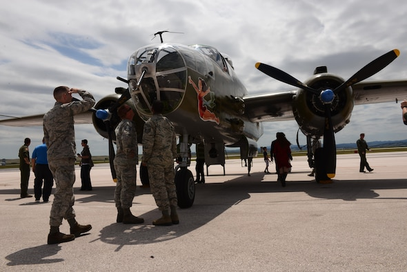 Airmen and their families view a B-25 Mitchell bomber on display during the 34th and 37th Bomb Squadron's 100th anniversary celebration at Ellsworth Air Force Base, S.D., June 12, 2017. The squadrons are two of the oldest in the Air Force, with the 34th BS formed on May 10, 1917, and the 37th on June 13, 1917. (U.S. Air Force photo by Airman 1st Class Donald C. Knechtel)