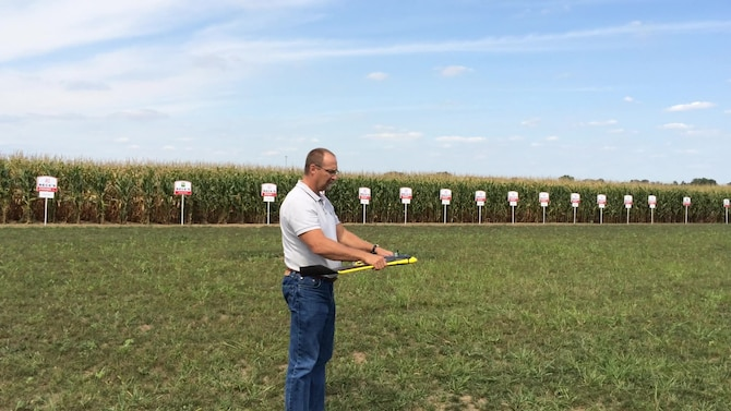 Joe Diemunsch, a computer engineer with AFRL and the first person to enter AFRL's Entrepreneurial Opportunities Program, prepares to launch a remotely piloted aircraft over a field of corn. Diemunsch is exploring the possibility of commercializing a tool that would be used with data received from sensors aboard an RPA to help farmers with more precise information about nutrient deficiencies, disease, pest damage and weeds. (U.S. Air Force photo)