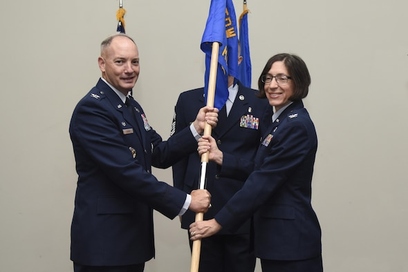 U.S. Air Force Col. Janet Urbanski, the new 17th Medical Group Commander, receives the guideon from Col. Michael Downs, 17th Training Wing Commander, during the 17th MDG Change of Command ceremony at the Event Center on Goodfellow Air Force Base, Texas, June 13, 2017. Urbanski previously served as commander of the 81st Medical Support Squadron out of Keesler Air Force Base. (U.S. Air Force photo by Airman 1st Class Chase Sousa/Released)