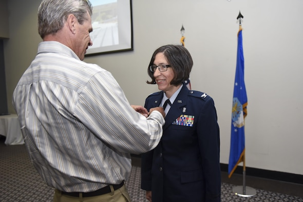 U.S. Air Force Col. Janet Urbanski, the new 17th Medical Group Commander, receives a command pin at the Event Center on Goodfellow Air Force Base, Texas, June 13, 2017. The pinning ceremony symbolizes filling the role of commander. (U.S. Air Force photo by Airman 1st Class Chase Sousa/Released)