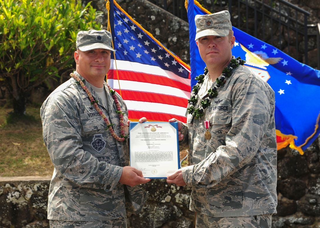 Lt. Col. Phillip Verroco, 21st Space Operations Squadron commander, presents Maj. Robert F. Shumaker, Detachment 3 outgoing commander, with the Meritorious Service Medal during the Detachment 3 Change of Command Ceremony, Kaena Point, Hawaii, June 9, 2017.  Detachment 3 is a component of the 21st Space Operations Squadron, 50th Network Operations Group, 50th Space Wing, and is located on the western tip of Oahu.  It is the oldest and one of seven worldwide remote tracking stations in the Air Force Satellite Control Network.  (U.S. Air Force photo by Tech. Sgt. Heather Redman)