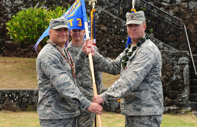 Lt. Col. Phillip Verroco, 21st Space Operations Squadron commander, takes the detachment flag from Maj. Robert F. Shumaker, Detachment 3 outgoing commander, during the Detachment 3 Change of Command Ceremony, Kaena Point, Hawaii, June 9, 2017.  Detachment 3 is a component of the 21st Space Operations Squadron, 50th Network Operations Group, 50th Space Wing, and is located on the western tip of Oahu.  It is the oldest and one of seven worldwide remote tracking stations in the Air Force Satellite Control Network.  (U.S. Air Force photo by Tech. Sgt. Heather Redman)
