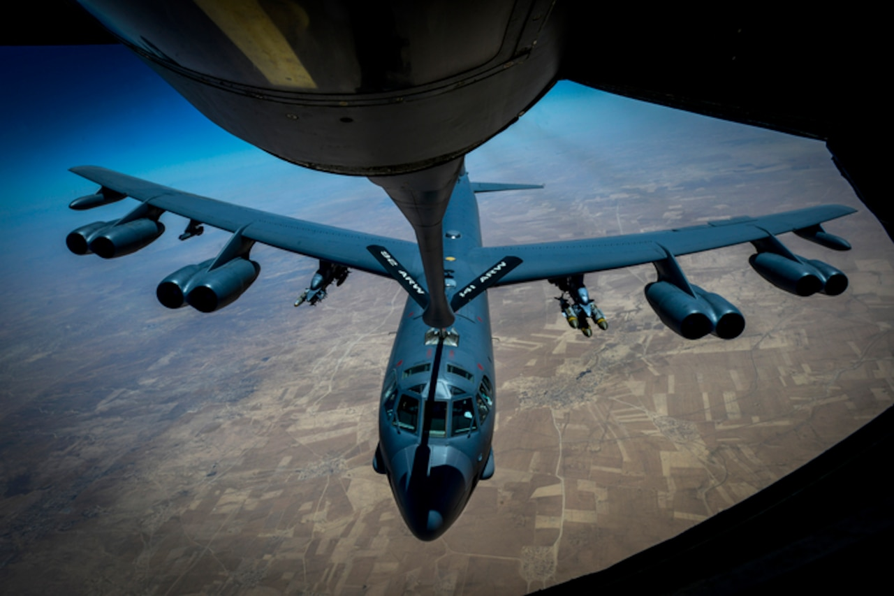 An Air Force B-52 Stratofortress bomber departs after receiving fuel from a KC-135 Stratotanker during a flight to support Operation Inherent Resolve, the coalition effort to defeat the Islamic State of Iraq and Syria, June 9, 2017. Air Force photo by Staff Sgt. Michael Battles