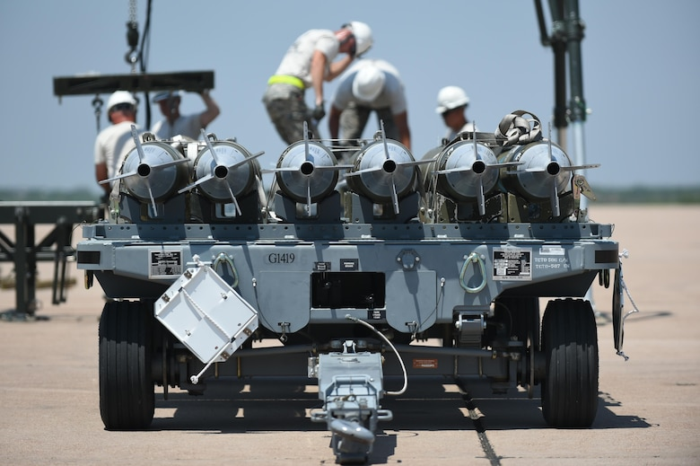 U.S. Air Force Airmen, assigned to the 7th Munitions Squadron, complete a bomb build as the final event in the 2017 Global Strike Challenge at Dyess Air Force Base, Texas, June 13, 2017. During the competition, 7th MUNS crew members built Joint Direct Attack Munitions and manufactured them on a munitions assembly conveyor. (U.S. Air Force photo by Airman 1st Class Emily Copeland)