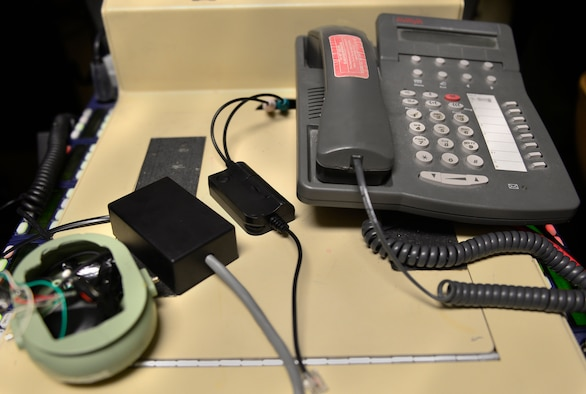 From left to right, the Frankenphone, the Frankenphone 2.0 and the headset connector are displayed June 12, 2017, at Creech Air Force Base, Nev. The Frankenphone has filled a gap for a long term solution to communications deficiencies by routing calls from the joint terminal attack controllers to the telephone and patching it into the aircrew's headsets. This has allowed MQ-9 aircrews to properly receive weapons strike guidance from the ground forces to take the fight to the enemy. The Frankenphone 2.0 offered improved durability and sound clarity while the headset connector is an evolution of the Frankenphone which is already integrated in the Audio Multi Level System. (U.S. Air Force photo/Senior Airman Christian Clausen)