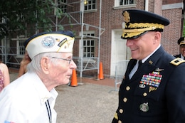 Maj. Gen. Troy D. Kok, commanding general of the U.S. Army Reserve's 99th Regional Support Command (right), speaks with Pvt. Alex Horanczy, a Pearl Harbor Survivor who served with the 42nd Infantry Division, prior to the start of the Stripes and Stars Festival celebrating the U.S. Army 242nd birthday June 14 at Independence Hall in Philadelphia.
