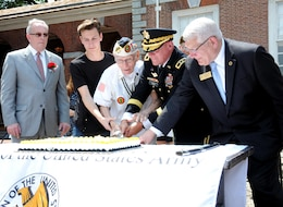 Cutting the Army Birthday cake June 14 during the Stripes and Stars Festival at Independence Hall in Philadelphia are (from left): James A. Donahue, president of the William Penn Chapter of the Association of the United States Army; Army Recruit Brian White, the youngest Soldier in attendance; Pvt. Alex Horanczy, the oldest Soldier in attendance who served with the 42nd Infantry Division and is a Pearl Harbor Survivor; Maj. Gen. Troy D. Kok, commanding general of the U.S. Army Reserve's 99th Regional Support Command; and retired Gen. Carter F. Ham, president and CEO of the Association of the United States Army and former commander of U.S. Africa Command.