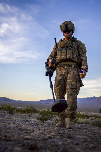 Staff Sgt. Jeremiah Alejandro, 99th Civil Engineer Squadron explosive ordnance disposal team member, performs an improvised explosive device clearance operation during a training exercise at the Nevada Test and Training Range June 7, 2017. The EOD teams alternated team members to perform the clearance operations to ensure each scenario was different. (U.S. Air Force photo by Airman 1st Class Andrew D. Sarver/Released)
