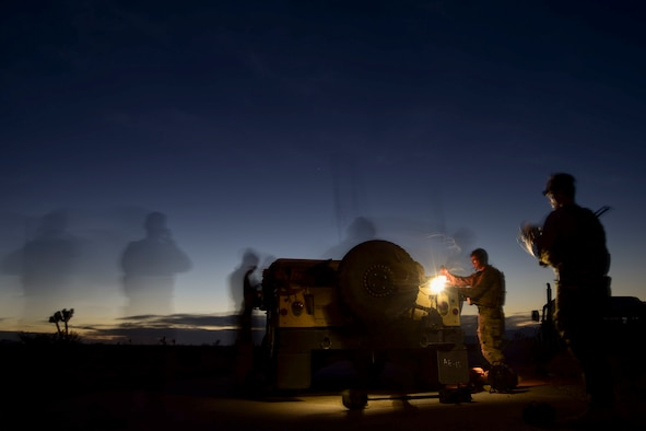 Senior Airman Michael Rodgers, 99th Civil Engineer Squadron explosive ordnance disposal team member, scouts the surrounding area while his team prepares for a night-time simulated roadside bomb clearance operation during a bivouac exercise at the Nevada Test and Training Range June 7, 2017. EOD team members use night vision goggles to help provide them the ability to operate in hours of darkness. (U.S. Air Force photo by Airman 1st Class Andrew D. Sarver/Released)