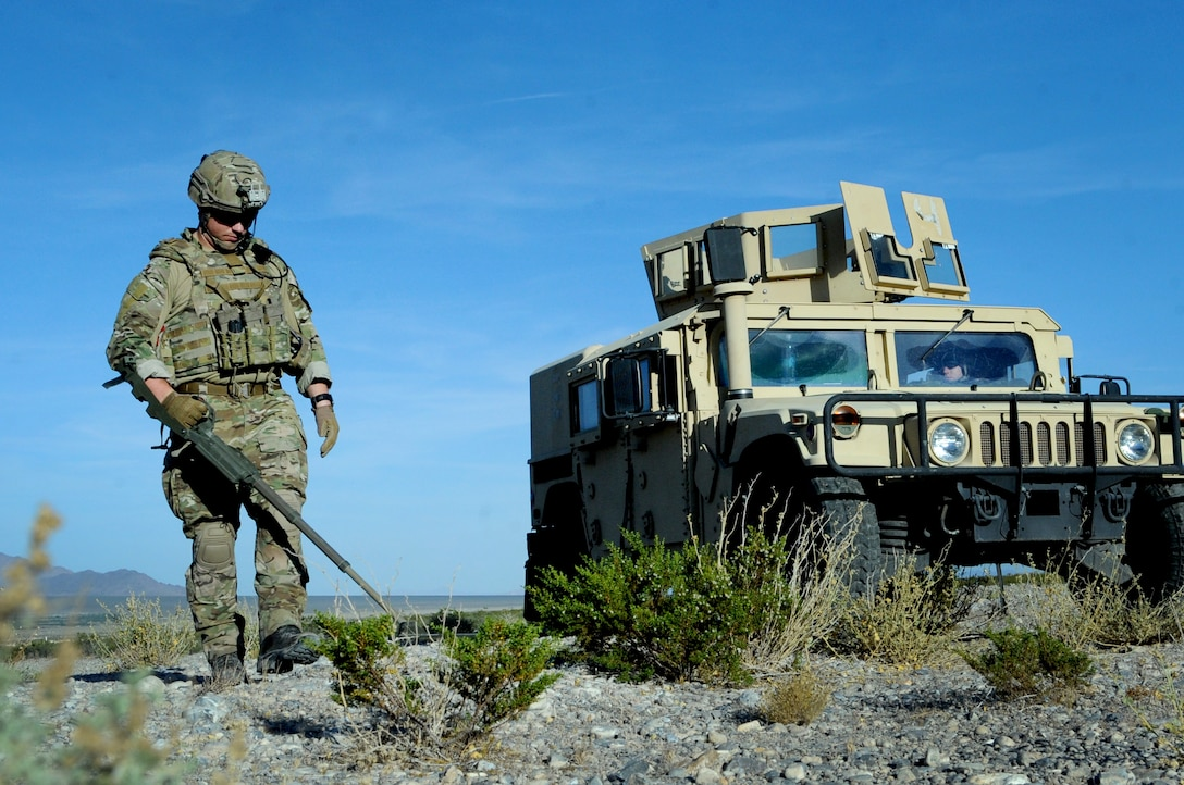 Tech Sgt. Nathaniel Jackson, 99th Civil Engineer Squadron explosive ordnance disposal technician, begins a roadside bomb clearing operation during a training event June 7, 2017 at the Nevada Test and Training Range. The EOD team members were taking part in series of training scenarios designed to test their skills in low-light situations. (U.S. Air Force photo by Senior Airman Joshua Kleinholz)