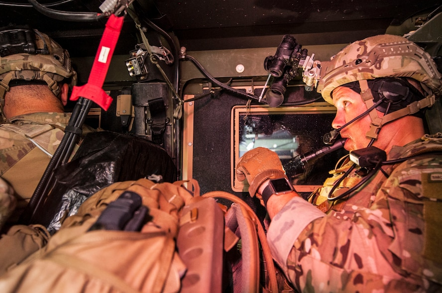 Tech. Sgt. Nathanial Jackson, 99th Civil Engineer Squadron explosive ordnance disposal technician, checks his night vision system during a roadside bomb clearing training event June 7, 2017 at the Nevada Test and Training Range. Low-light situations add another layer of difficulty to a task that already requires the highest level of attention to detail. (U.S. Air Force photo by Senior Airman Joshua Kleinholz/Released)