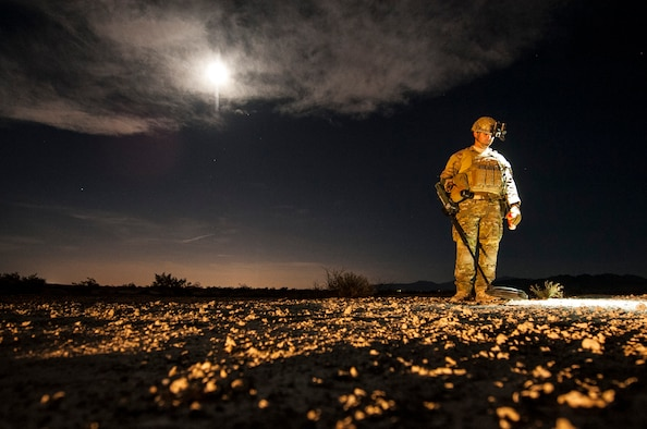 Staff Sgt. Brian Cole, 99th Civil Engineer Squadron explosive ordnance disposal technician, performs a roadside bomb clearing operation during a training event, June 7, 2017 on the Nevada Test and Training Range. Training in low-light conditions ensures that EOD Airmen are ready and able to respond to threats wherever, and whenever, they're called. (U.S. Air Force photo by Senior Airman Joshua Kleinholz)