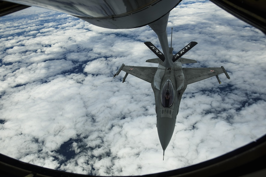 A Polish air force F-16 Fighting Falcon refuels from a KC-135R Stratotanker, 100th Air Refueling Wing, over Latvia, June 14, 2017. The exercise is designed to enhance flexibility and interoperability, to strengthen combined response capabilities, as well as demonstrate resolve among Allied and Partner Nations' forces to ensure stability in, and if necessary defend, the Baltic Sea region. (U.S. Air Force photo by Staff Sgt. Jonathan Snyder)