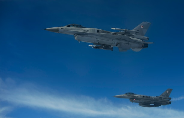 Two Polish air force F-16 Fighting Falcons break away after refueling from a KC-135R Stratotanker during BALTOPS over Latvia, June 14, 2017. The exercise is designed to enhance flexibility and interoperability, to strengthen combined response capabilities, as well as demonstrate resolve among Allied and Partner Nations' forces to ensure stability in, and if necessary defend, the Baltic Sea region. (U.S. Air Force photo by Staff Sgt. Jonathan Snyder)