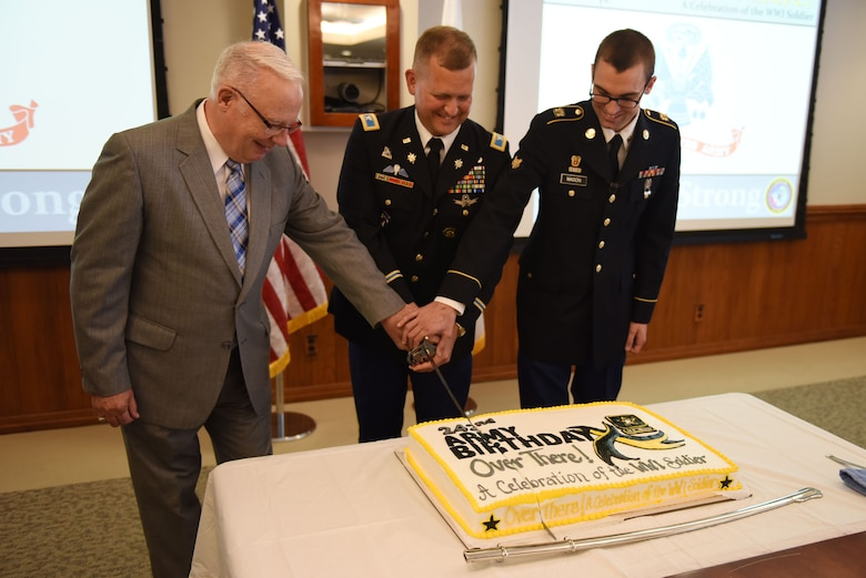 Retired Army Col. Geoff Moran, Army Col. Brian Moore, Joint Functional Component Command for Space director of operations and exercises, and Army Spc. Alan Mason, Joint Space Operations Center defensive duty technician, cut a birthday cake for the Army's 242nd birthday, June 14, 2017, Vandenberg Air Force Base, Calif. Members from all branches were in attendance to celebrate the impact and contributions of soldiers dating all the way back to 1775. (U.S. Air Force photo by Senior Airman Robert J. Volio/Released)