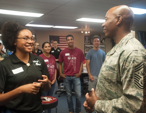 Chief Master Sgt. of the Air Force Kaleth O. Wright speaks with Senior Airman Jordan Howard, a member of the Wired Bean council, June 12, 2017, at Kadena Air Base, Japan. The Wired Bean offers Airmen an alcohol-free, tobacco-free, and profanity-free environment to have fun, meet friends, and give back to the community. Wright visited Pacific Air Forces bases to discuss his priorities, mission readiness through resilience and accomplishments of PACAF Airmen. (U.S. Air Force photo by Senior Airman Quay Drawdy)