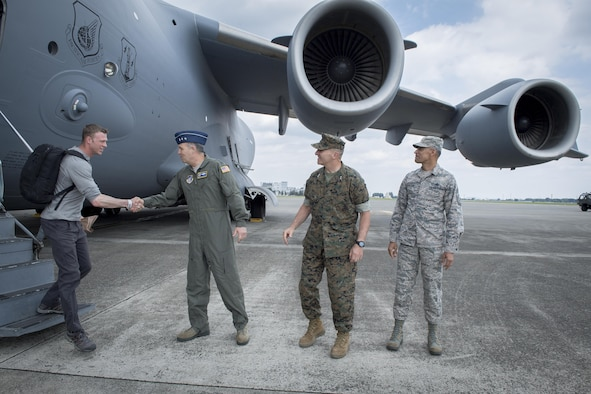U.S. Air Force Lt. Gen. Jerry P. Martinez, far left, U.S. Forces Japan and 5th Air Force commander, greets Noncombatant Evacuation Operations (NEO) exercise participants at Yokota Air Base, Japan, June 6, 2017. The decision to conduct a NEO is made on a case by case basis due to natural disasters, civil unrest or military conflict to ensure the safety of the estimated 228,000 U.S. citizen residents and tourists in the Republic of Korea. (U.S. Air Force photo/Airman 1st Class Donald Hudson)