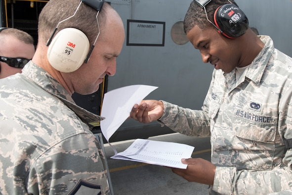 (Right to left) Airman 1st Class Braxton Ramsue, 730th Air Mobility Squadron passenger service agent, and Master Sgt. Victor Peterson, 730th Air Mobility Squadron passenger service superintendent, check passenger lists during noncombatant evacuation exercise Focused Passage 2017 at Yokota Air Base, Japan, June 6, 2017. FP 2017 is designed to ensure Eighth Army service members and families are prepared to evacuate during a crisis situation. (U.S. Air Force photo by Yasuo Osakabe/Released)