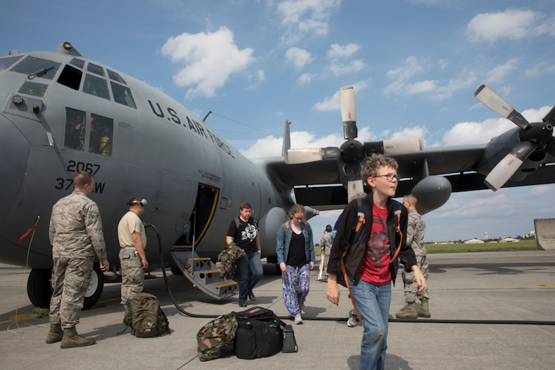 Family members representing installations and commands throughout the Korean Peninsula exist a U.S. Air Force C-130 Hercules at Yokota Air Base, Japan, June 6, 2017 for noncombatant evacuation exercise Focused Passage 2017. The exercise takes place at US military installations throughout the Korean Peninsula and is designed to ensure service members are prepared to evacuate designated noncombatants. (U.S. Air Force photo by Yasuo Osakabe)