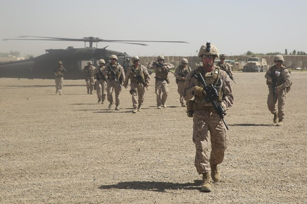U.S. Marines with Task Force Southwest depart a UH-60 Blackhawk helicopter prior to an advisory meeting with Afghan National Army soldiers at Camp Hanson, Afghanistan, June 13, 2017. Marines and Sailors from Task Force Southwest are currently supporting and assisting the 1st and 3rd Brigades of the 215th Corps during Maiwand Three offensive operations to clear insurgents from the Nad-e Ali and Marjah areas. (U.S. Marine Corps photo by Sgt. Lucas Hopkins)