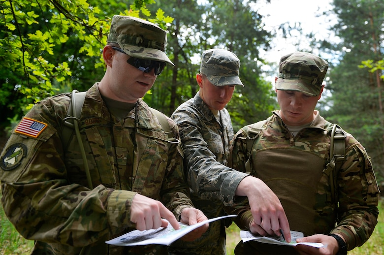 U.S. Airmen from the 7th Weather Squadron conduct land navigation at the Mainz Sand Dunes, Germany, June 13, 2017. Airmen of the 7th WS use Exercise Cadre Focus to help enhance their capability to cooperate with the U.S. Army. (U.S. Air Force photo by Airman 1st Class Joshua Magbanua)