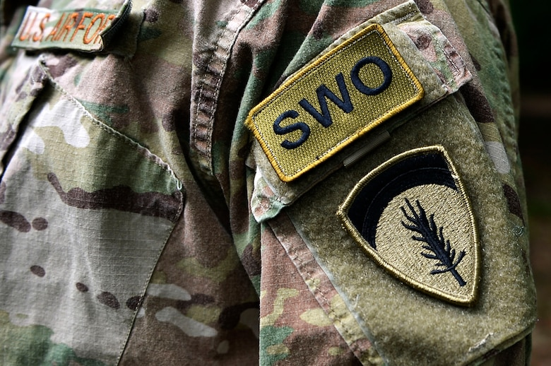 A U.S. Airman displays their staff weather officer patch at the Mainz Sand Dunes, Germany, June 13, 2017. The 7th Weather Squadron is responsible for providing weather support for U.S. Army operations in Europe. (U.S. Air Force photo by Airman 1st Class Joshua Magbanua)