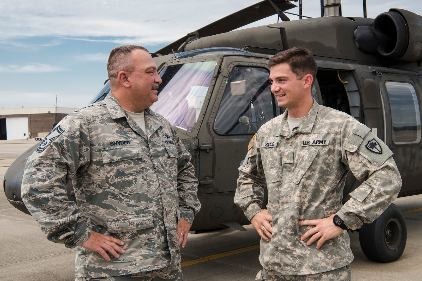 U.S. Army 2nd Lt. Michael Snyder with A Co. 1-111th General Support Aviation Battalion and U.S. Air Force Senior Master Sgt. Edward Snyder with the 169th Fighter Wing pose for a photograph at McEntire Joint National Guard Base in Eastover, South Carolina, June 13, 2017.
