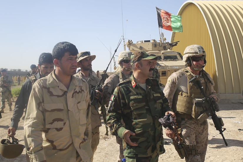 Afghan National Army Brig. Gen. Ahmadzai, center, the commanding general of the 215th Corps, and U.S. Marine Brig. Gen. Roger Turner, right, the commanding general of Task Force Southwest, speak following an advisory meeting at Camp Hanson, Afghanistan, June 13, 2017. Several Marine advisors met with their Afghan counterparts to discuss current Maiwand Three operations in Nad-e Ali and Marjah. The 215th Corps' 1st and 3rd Brigades are currently clearing the aforementioned cities with assistance and support from Task Force Southwest. (U.S. Marine Corps photo by Sgt. Lucas Hopkins)