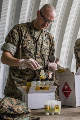 Gunnery Sgt. Vance Bercot prepares a liquid binary explosive called TEXPAK during demolition exercise at the Explosive Ordnance Range aboard Marine Corps Air Station Beaufort, June 1. The MCAS Beaufort EOD Marines conducted the demolition exercise to detonate unused TEXPAK explosives left over from the 2017 MCAS Beaufort Air Show and to practice for future air shows. Bercot is an EOD technician with EOD, MCAS Beaufort.