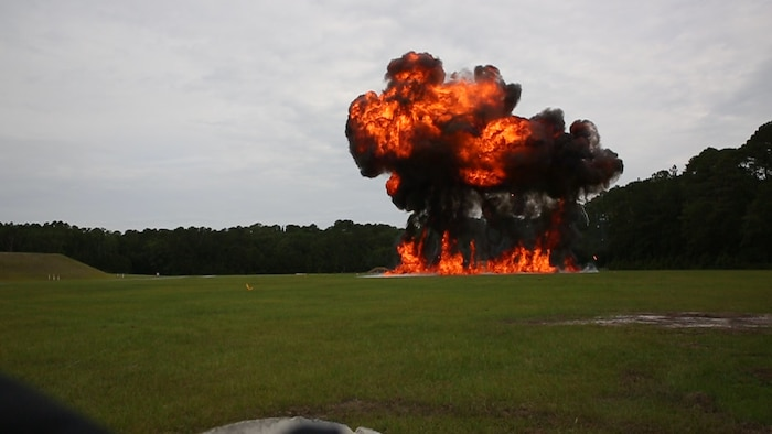 'The  wall  of  fire'  pyrotechnic  display  detonates  during  a  demolition  exercise  at  the  Explosive  Ordnance  Range  aboard  Marine  Corps  Air  Station  Beaufort,  June  1.  The  MCAS Beaufort EOD Marines created the pyrotechnic display by detonating four-gallon bags of fuel laid out along a detonation cord. The MCAS Beaufort EOD Marines conducted  the  demolition  exercise  to  detonate  unused  explosives  from  the  2017  MCAS Beaufort Air Show using the opportunity to practice for future air shows.