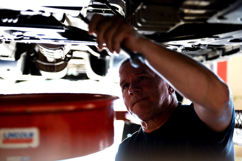 Thomas Johnson, 19th Force Support Squadron Auto Hobby Shop lead mechanic, drains the oil of a car June 9, 2017, at Little Rock Air Force Base, Ark. Johnson said that oil changes and brake problems are the most common issues customers come in with. (U.S. Air Force photo by Airman Rhett Isbell)