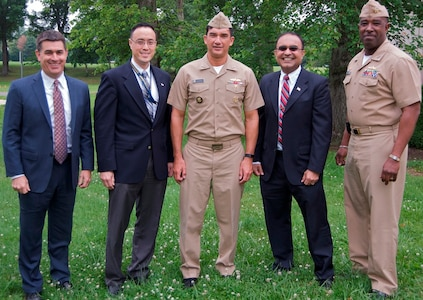DAHLGREN, Va. - Rear Adm. Patrick Piercey, Naval Surface Force Atlantic commander, center, is pictured with Naval Surface Warfare Center Dahlgren Division (NSWCDD) leadership at the command's Asian American and Pacific Islander Heritage Month Observance. After his keynote speech, Piercey received technical briefings during a tour of NSWCDD facilities and laboratories dedicated to directed energy, surface warfare, and cybersecurity research, development, test and evaluation. Standing left to right: Dale Sisson, NSWCDD deputy technical director; Jim Yee, NSWCDD deputy department head for gun and electric weapon systems; Piercey; Gaurang Dävé, NSWCDD senior cyber technical advisor; and Capt. Gus Weekes, NSWCDD commanding officer.