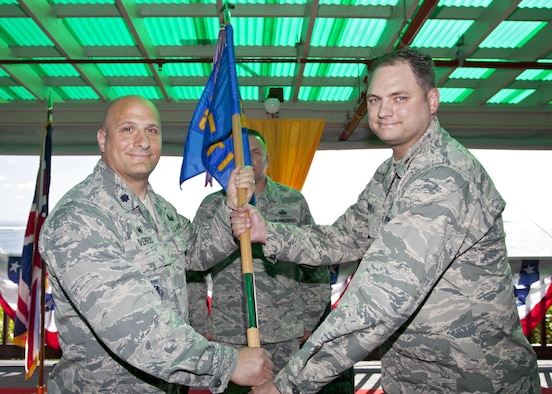 Lt. Col. Phillip Verroco, 21st Space Operations Squadron commander, presents the unit guidon to Maj. Derrick Russell during the 21 SOPS, Detachment 1 change of command ceremony at Diego Garcia, British Indian Ocean Territory, Wednesday, June 6, 2017. Russell assumed command of the detachment from Maj. Tyler Westerberg. (Courtesy photo)