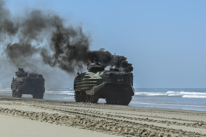 An Assault Amphibious Vehicles, with 15th Marine Expeditionary Unit, departs Red Beach during the Marine Air- Ground Task Force demonstration for the 75th Anniversary on Camp Pendleton, Calif., June 14, 2017. The demonstration allowed civilians to observe Marines as they recertified their qualifications before deployment. (U. S. Marine Corps photo by Lance Cpl. Betzabeth Y. Galvan)