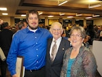 Brett Gillard poses with his mother, Peggy Gillard, and grandfather, Ernie Schramm, following graduation from the Puget Sound Naval Shipyard Apprentice Program. Brett and his mother are current employees and Schramm retired from the command in 1981. (Personal photo provided by Peggy Gillard)