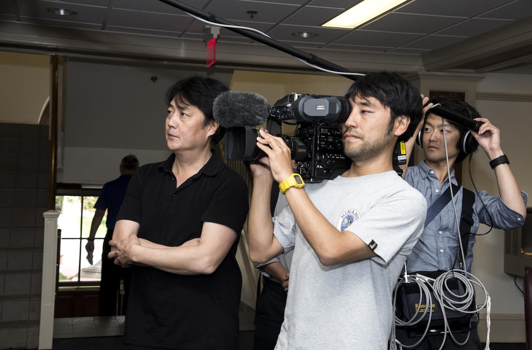 A news crew member from the Nippon Hoso Kyokia (Japan Broadcasting Corporation) films Air University Headquarters at Maxwell Air Force Base, Ala., June 15, 2017. The film will be used for an upcoming documentary about the Air Corps Tactical School, which was located at Maxwell from 1931 to 1942 and played a major role in the Allied air domination over Japan during WWII. The NHK crew visited Maxwell in December 2016 for their documentary about a group whose mission was to protect and salvage works of art during WWII. The NHK has an average viewership of 11 million. (U.S. Air Force photo/Senior Airman Alexa Culbert)