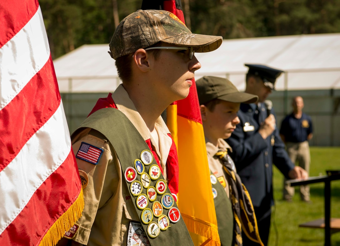 Children of Ramstein personnel who are members of the Boy Scouts of America act as color guard for the U.S. and German flags during a Flag Day flag disposal ceremony on Ramstein Air Base, Germany, June 14, 2017. The Boy Scouts of America supported the ceremony to help make sure that the flags were given proper respect during their disposal as defined by the United States Flag Code. (U.S. Air Force photo by Senior Airman Elizabeth Baker.)